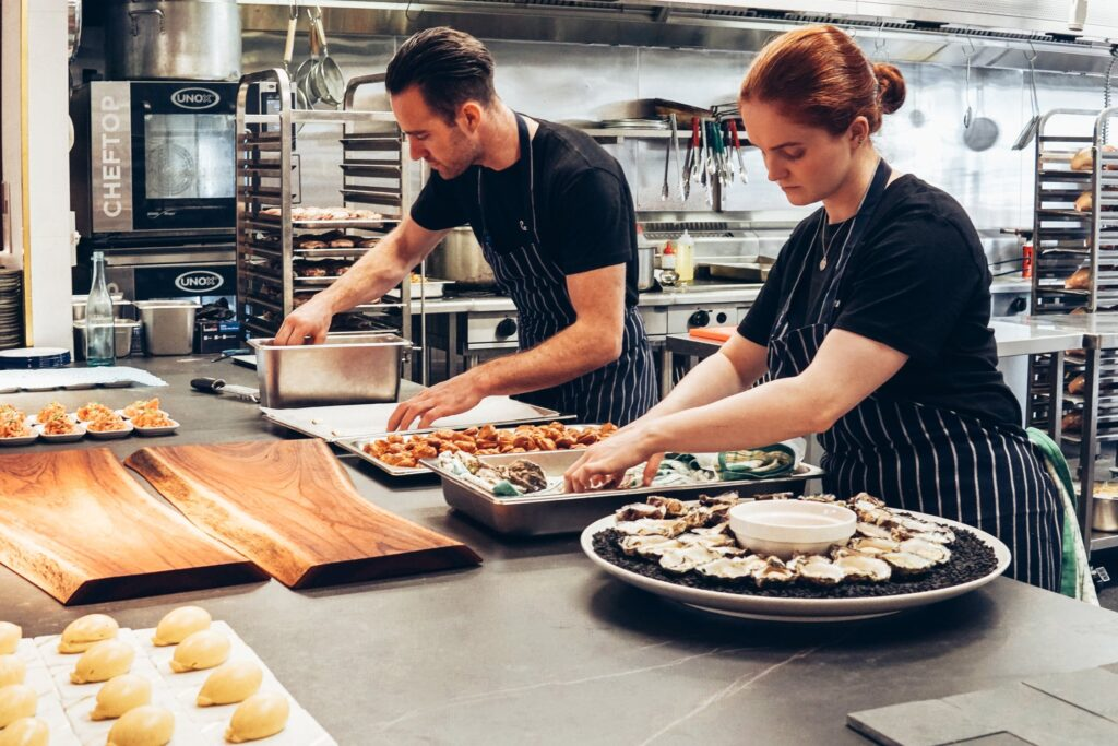 Commercial Cooking two cooks in the kitchen preparing canape